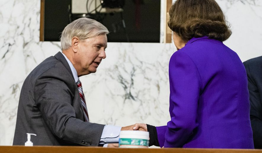 Sen. Lindsey Graham, R-S.C., shakes hands with Sen. Dianne Feinstein, D-Calif., at the close of the confirmation hearing for Supreme Court nominee Amy Coney Barrett, before the Senate Judiciary Committee, Thursday, Oct. 15, 2020, on Capitol Hill in Washington. (Samuel Corum/Pool via AP)