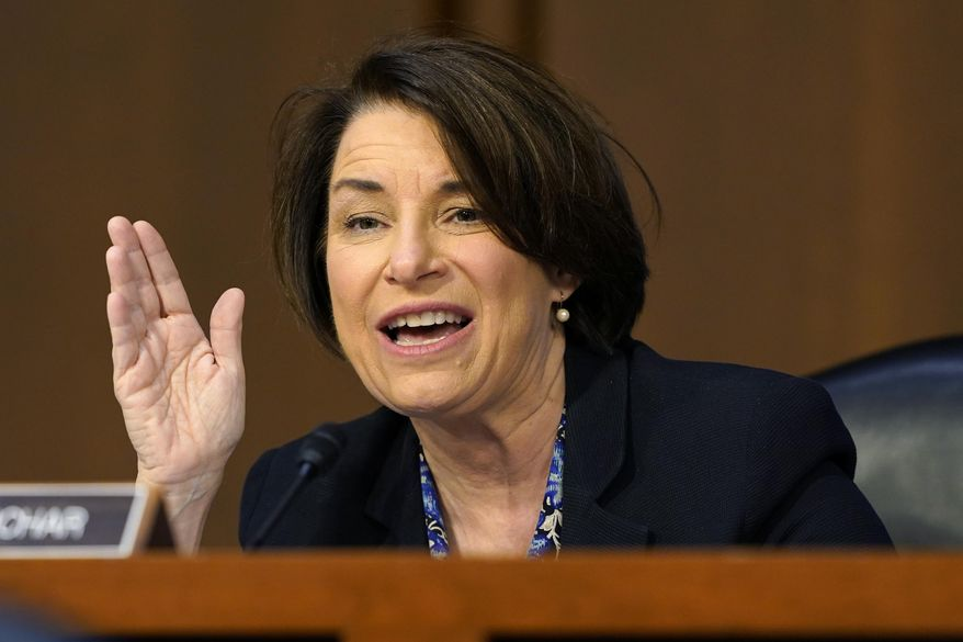 Sen. Amy Klobuchar, D-Minn., speaks before the Senate Judiciary Committee during the confirmation hearing for Supreme Court nominee Amy Coney Barrett, Thursday, Oct. 15, 2020, on Capitol Hill in Washington. (AP Photo/Susan Walsh, Pool)