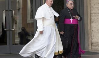 FILE - In this Oct. 5, 2015 file photo, Pope Francis, flanked by bishop Marcello Semeraro, leaves at the end of a morning session of the Synod of bishops, at the Vatican. On Thursday, Oct. 15, 2020 the Vatican announced that Pope Francis nominated Semeraro as Prefect for the Congregation of the Saints. (AP Photo/Alessandra Tarantino, file)