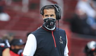 Cincinnati head coach Luke Fickell works the sideline during an NCAA college football game against South Florida, Saturday, Oct. 3, 2020, in Cincinnati. No. 8 Cincinnati's game at Tulsa on Saturday has been postponed because of positive COVID-19 tests among Bearcats players. The American Athletic Conference announced Thursday, Oct. 15, the game is being rescheduled for Dec. 5. (AP Photo/Aaron Doster, File)