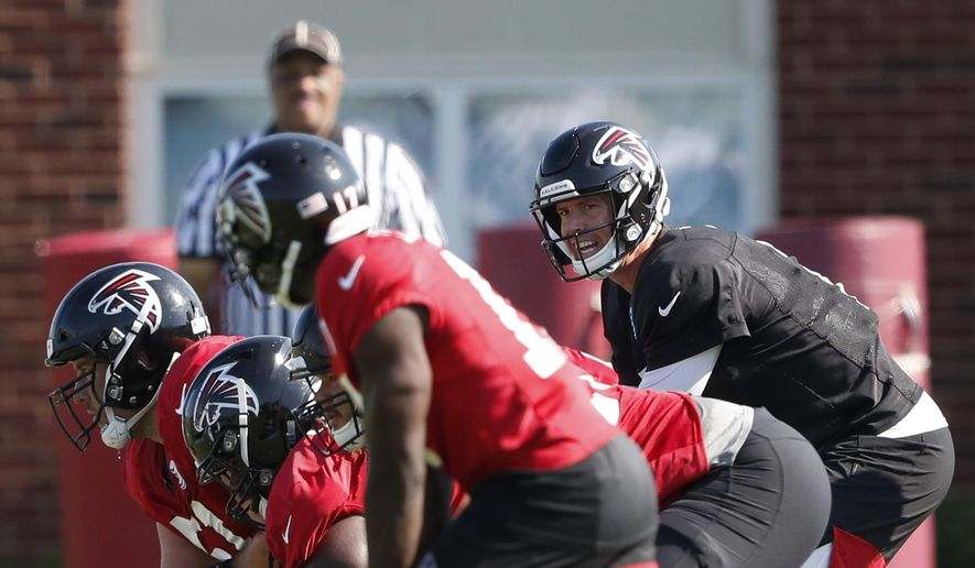 In this July 25, 2019, file photo, Atlanta Falcons quarterback Matt Ryan (2) and the offense prepare to run a play during their NFL training camp football practice in Flowery Branch, Ga. The Atlanta Falcons shut their facility Thursday, Oct. 15, 2020, following one new positive test for COVID-19. The team remains scheduled to play at Minnesota on Sunday. (AP Photo/John Bazemore, File)  **FILE**
