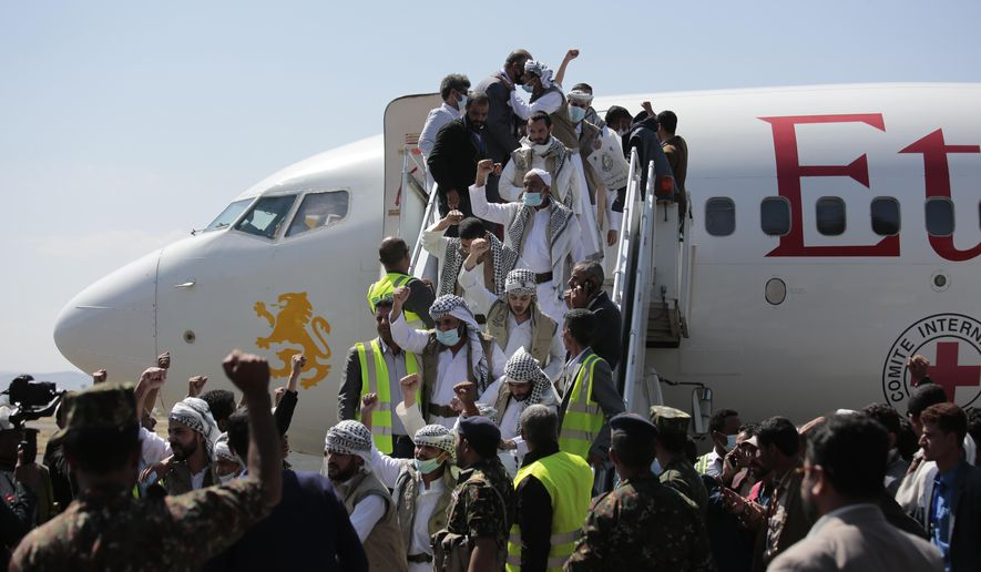 Yemeni prisoners chant slogans during their arrival after being released by the Saudi-led coalition in the airport of Sanaa, Yemen, Thursday, Oct. 15, 2020. (AP Photo/Hani Mohammed)