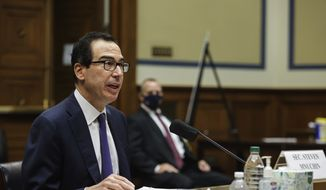 In this Sept. 1, 2020 file photo, Treasury Secretary Steven Mnuchin testifies before the House Select Subcommittee on the Coronavirus Crisis, during a hybrid hearing on Capitol Hill in Washington. The federal budget deficit hit an all-time high of $3.1 trillion in the 2020 budget year, more than double the previous record, as the coronavirus pandemic shrank revenues and sent spending soaring. The Trump administration reported Friday, Oct. 16,  that the deficit for the budget year that ended on Sept. 30 was three times the size of last year's deficit of $984 billion. (Graeme Jennings/Pool via AP) **FILE**