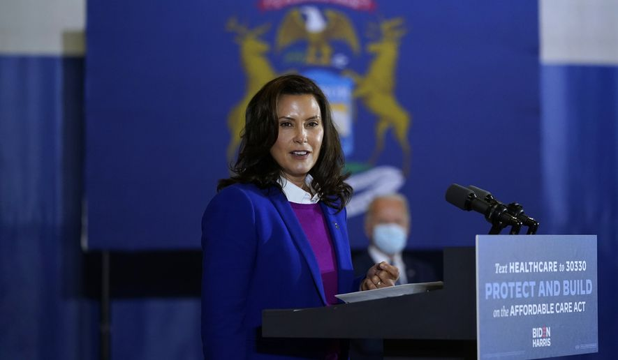 Michigan Gov. Gretchen Whitmer speaks as Democratic presidential candidate former Vice President Joe Biden listens during an event at Beech Woods Recreation Center, in Southfield, Mich., Friday, Oct. 16, 2020. (AP Photo/Carolyn Kaster)