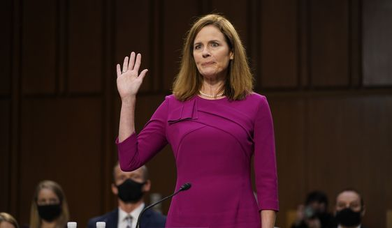 Supreme Court nominee Amy Coney Barrett is sworn in during a confirmation hearing before the Senate Judiciary Committee, Monday, Oct. 12, 2020, on Capitol Hill in Washington. (AP Photo/Patrick Semansky, Pool) ** FILE **