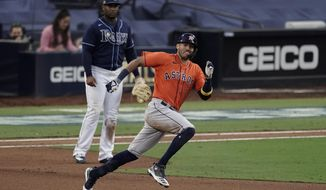 Houston Astros Carlos Correa runs to second after hitting a double against the Tampa Bay Rays during the seventh inning in Game 6 of a baseball American League Championship Series, Friday, Oct. 16, 2020, in San Diego. (AP Photo/Jae C. Hong)