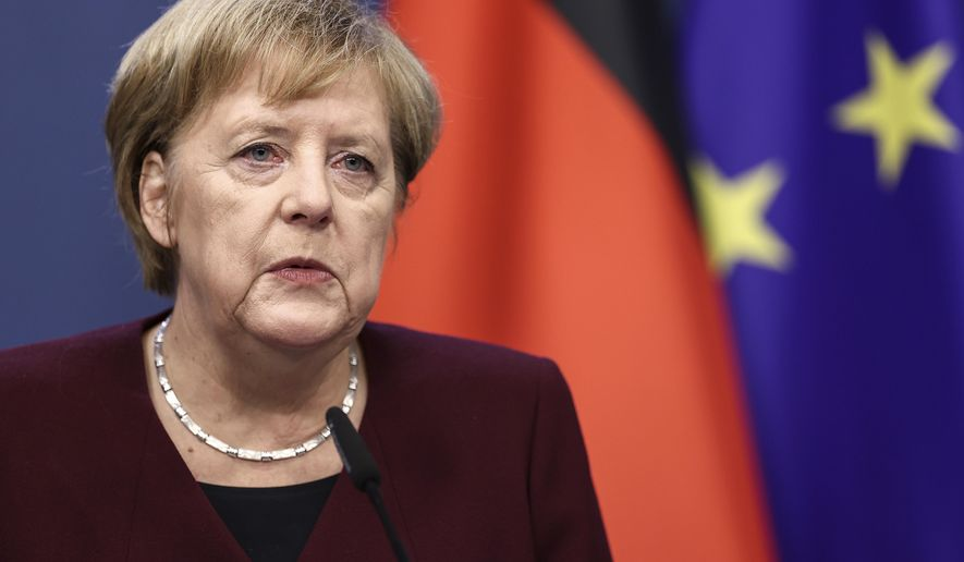 German Chancellor Angela Merkel speaks during a media conference at the end of an EU summit in Brussels, Friday, Oct. 16, 2020. European Union leaders met for the second day of an EU summit, amid the worsening coronavirus pandemic, to discuss topics on foreign policy issues. (Kenzo Tribouillard, Pool via AP)