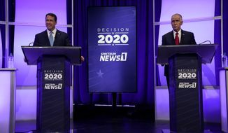 Democratic challenger Cal Cunningham, left, and U.S. Sen. Thom Tillis, R-N.C. wait for the start of a televised debate Thursday, Oct. 1, 2020 in Raleigh, N.C. (AP Photo/Gerry Broome, Pool)