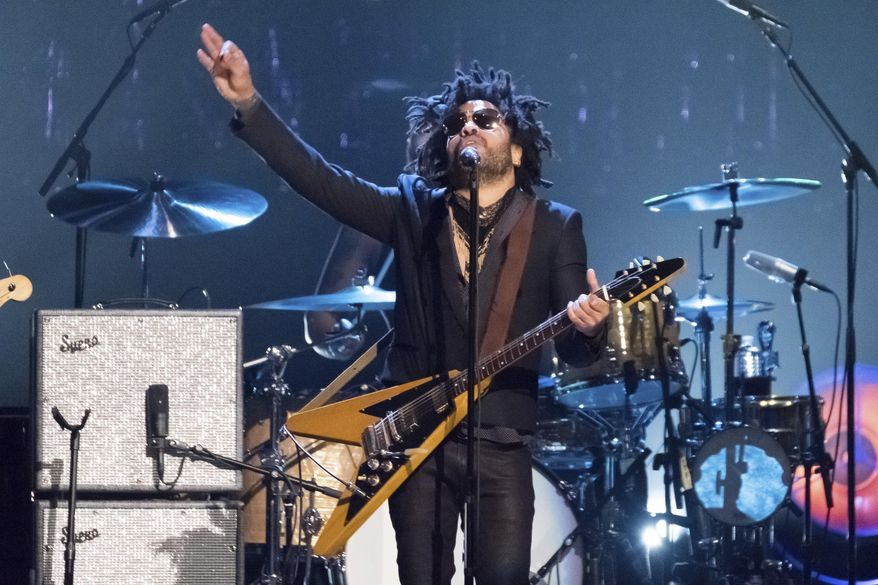 """FILE - Lenny Kravitz performs at the 2017 Rock and Roll Hall of Fame induction ceremony in New York on April 7, 2017. In a new memoir, """"Let Love Rule,"""" Kravitz explores his childhood and ends with him on the verge of stardom and deeply in love with actress Lisa Bonet.  (Photo by Charles Sykes/Invision/AP, File)"""