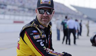 FILE - In this Aug. 31, 2019, file photo, Clint Bowyer waits on pit road for his turn to qualify for the NASCAR Cup Series auto race at Darlington Raceway in Darlington, S.C. wyer, popular among his peers and a beloved by fans, would have preferred a proper send-off in his final year as a NASCAR driver. Instead, he'll settle for a farewell party Sunday at Kansas Speedway. Bowyer is retiring from racing at the end of this season and move into the Fox Sports booth. (AP Photo/Terry Renna, File)