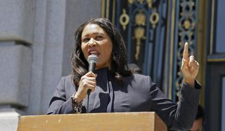 FILE - In this June 1, 2020, file photo, San Francisco Mayor London Breed speaks outside City Hall in San Francisco. Mayor Breed is blasting an effort to rename nearly four dozen San Francisco public schools honoring dead presidents and even U.S. Sen. Dianne Feinstein, saying the school district should focus on getting children back into the classroom if they want to address systemic racism. (AP Photo/Eric Risberg, File)