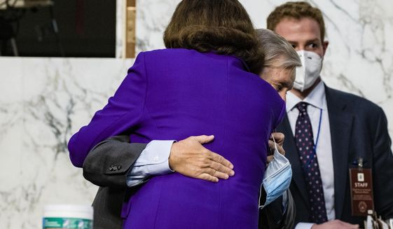 Sen. Lindsey Graham, R-S.C., hugs Sen. Dianne Feinstein, D-Calif., at the close of the confirmation hearing for Supreme Court nominee Amy Coney Barrett, before the Senate Judiciary Committee, Thursday, Oct. 15, 2020, on Capitol Hill in Washington. (Samuel Corum/Pool via AP)