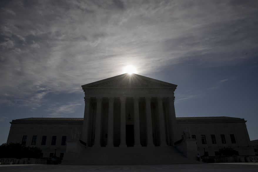 This May 4, 2020, file photo shows the Supreme Court building in Washington. Controversial Trump administration policies on the census, asylum seekers and the border wall, held illegal by lower courts, are on the Supreme Court's agenda Friday, Oct. 16, 2020. (AP Photo/Andrew Harnik, File)