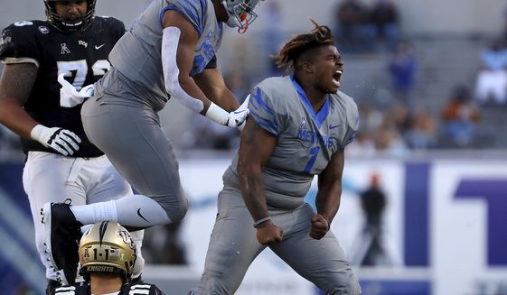 Memphis defensive lineman O'Bryan Goodson (1) celebrates after sacking Central Florida quarterback Dillon Gabriel (11) during an NCAA college football game Saturday, Oct. 17, 2020, in Memphis, Tenn. (Patrick Lantrip/Daily Memphian via AP)