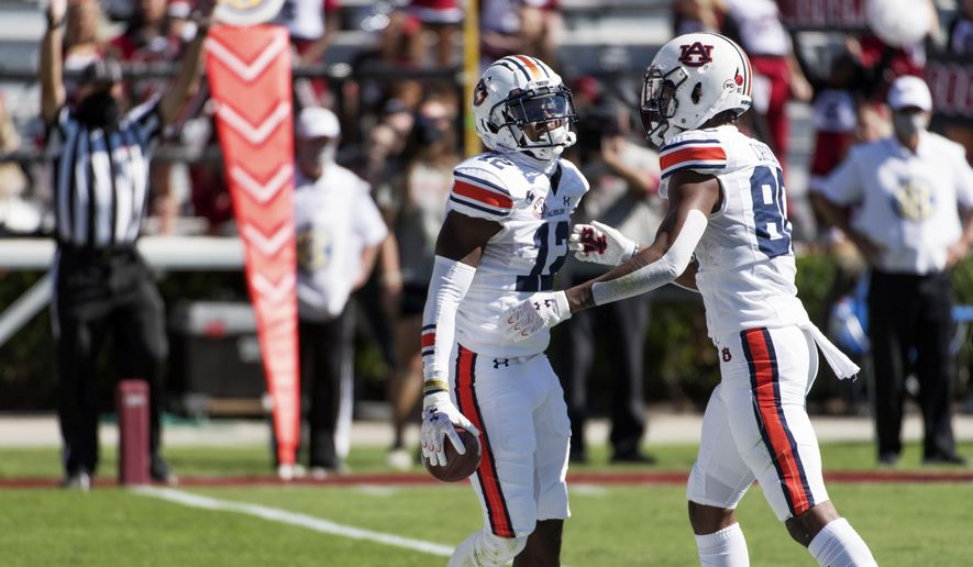 Auburn wide receiver Eli Stove (12) celebrates a touchdown with Ze'Vian Capers (80) during the first half of an NCAA college football game against South Carolina, Saturday, Oct. 17, 2020, in Columbia, S.C. (AP Photo/Sean Rayford)