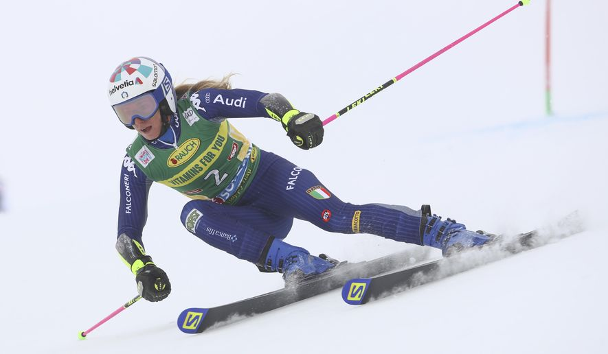 Italy's Marta Bassino speeds down the course during an alpine ski, women's World Cup giant slalom in Soelden, Austria, Saturday, Oct. 17, 2020. (AP Photo/Marco Trovati)