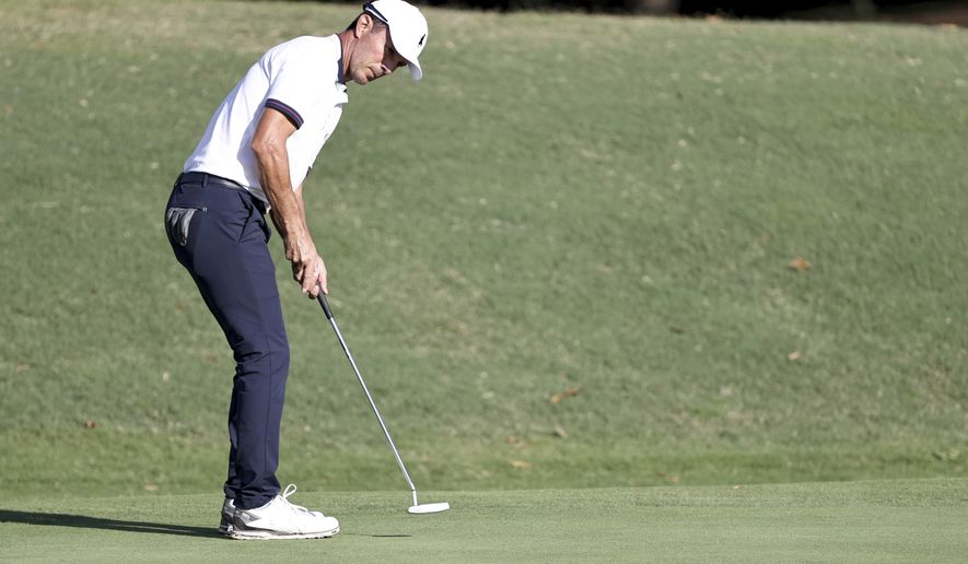 Mike Weir looks on his birdie putt in the 18th hole during the second round of Dominion Energy Charity Classic golf tournament at The Country Club of Virginia in Richmond, Va., Saturday, Oct. 17, 2020. (Daniel Sangjib Min/Richmond Times-Dispatch via AP)