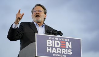 Sen. Gary Peters, D-Mich., speaks during an event for Democratic presidential candidate former Vice President Joe Biden at Michigan State Fairgrounds in Novi, Mich., Friday, Oct. 16, 2020. (AP Photo/Carolyn Kaster)