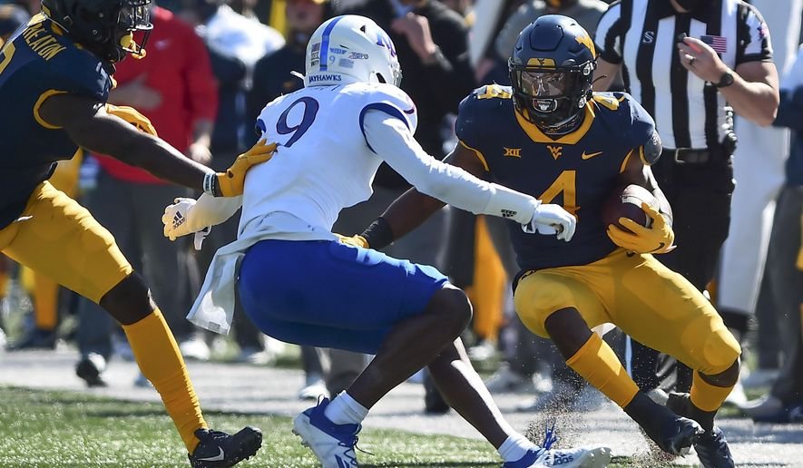 West Virginia running back Leddie Brown (4) rushes the ball against Kansas during an NCAA college football game, Saturday, Oct. 17, 2020, in Morgantown, W.Va. (William Wotring/The Dominion-Post via AP)
