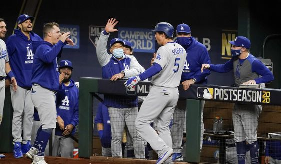 Los Angeles Dodgers' Corey Seager celebrates his two-run home run against the Atlanta Braves during the seventh inning in Game 5 of a baseball National League Championship Series Friday, Oct. 16, 2020, in Arlington, Texas. (AP Photo/Tony Gutierrez)