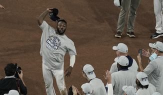 Tampa Bay Rays left fielder Randy Arozarena celebrates his MVP award following their victory against the Houston Astros in Game 7 of a baseball American League Championship Series, Saturday, Oct. 17, 2020, in San Diego. The Rays defeated the Astros 4-2 to win the series 4-3 games. (AP Photo/Jae C. Hong)