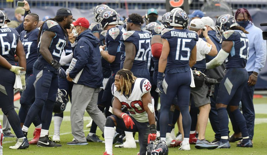 Houston Texans strong safety Justin Reid (20) kneels on the field as Tennessee Titans players celebrate after the Titans won 42-36 in overtime at an NFL football game Sunday, Oct. 18, 2020, in Nashville, Tenn. (AP Photo/Mark Zaleski)