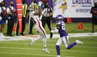 Atlanta Falcons wide receiver Russell Gage, left, catches a pass over Minnesota Vikings cornerback Jeff Gladney, right, during the second half of an NFL football game, Sunday, Oct. 18, 2020, in Minneapolis. (AP Photo/Bruce Kluckhohn)