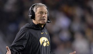 In this Dec. 27, 2019, file photo, Iowa head coach Kirk Ferentz reacts during the second half of the Holiday Bowl NCAA college football game against Southern California. The University of Iowa said it would not pay a demand from eight Black former football players for $20 million in compensation for alleged racial discrimination they faced while they played for the Hawkeyes. The players also called for the firings of Kirk Ferentz, offensive line coach Brian Ferentz and athletic director Gary Barta. (AP Photo/Orlando Ramirez, File)  **FILE**