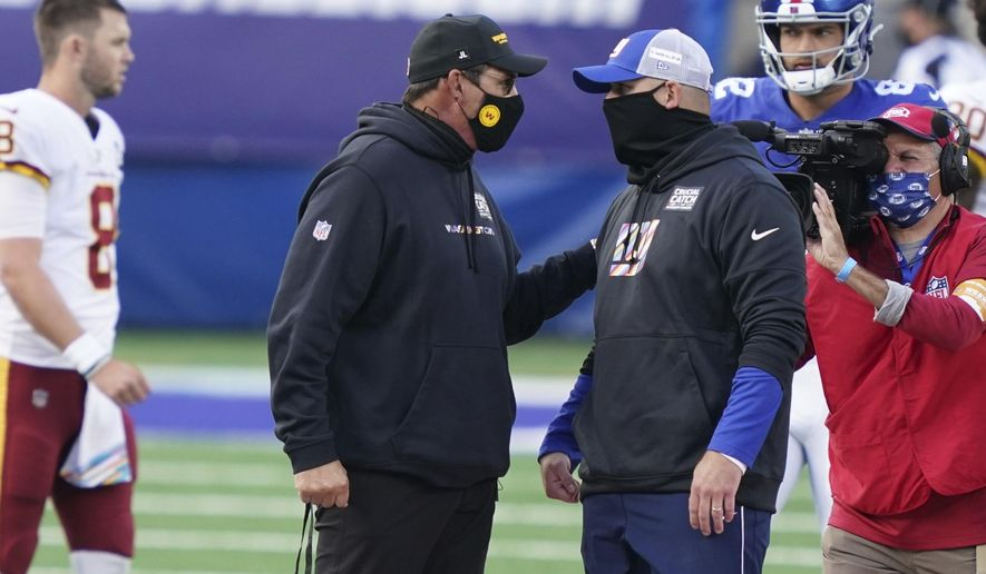 Washington Football Team's Ron Rivera, left, talks to New York Giants' Joe Judge, right, after an NFL football game Sunday, Oct. 18, 2020, in East Rutherford, N.J. The Giants won 20-19. (AP Photo/John Minchillo)