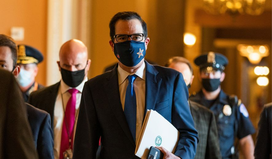 "Treasury Secretary Steven T. Mnuchin (center) said he and House Speaker Nancy Pelosi ""continued to narrow their differences"" on the coronavirus relief package, but have not reached a deal, just 24 hours before the deadline for an Election Day deal. (Associated Press)"