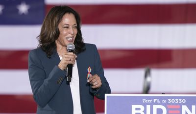 Democratic vice presidential candidate Sen. Kamala Harris, D-Calif., speaks to supporters at a campaign event Monday, Oct. 19, 2020, in Orlando, Fla. (AP Photo/John Raoux)