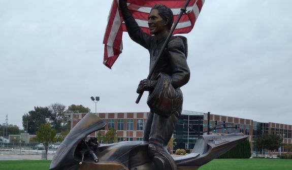 A lifesize bronze sculpture of international motorcycle racing sensation Nicky Hayden is located in his hometown of Owensboro, Kentucky. (Cheryl Chumley/The Washington Times)