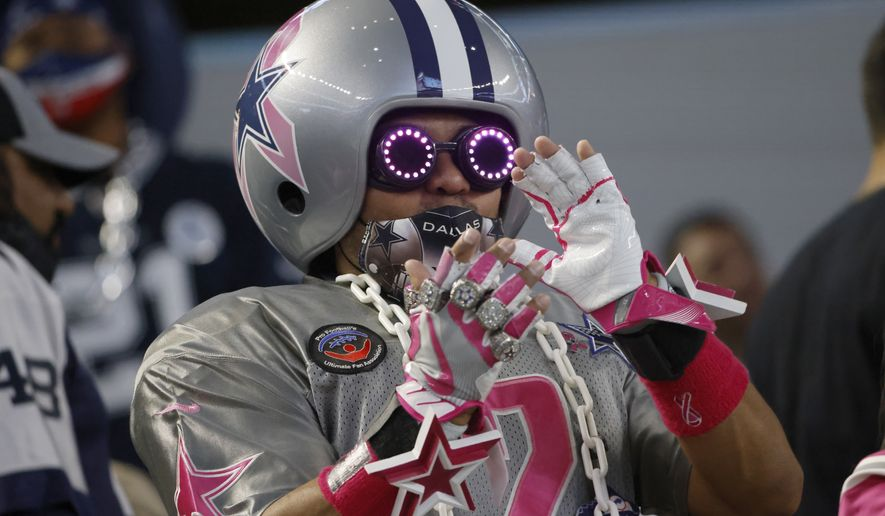 A Dallas Cowboys fan cheers in the first half of an NFL football game against the Arizona Cardinals in Arlington, Texas, Monday, Oct. 19, 2020. (AP Photo/Ron Jenkins)