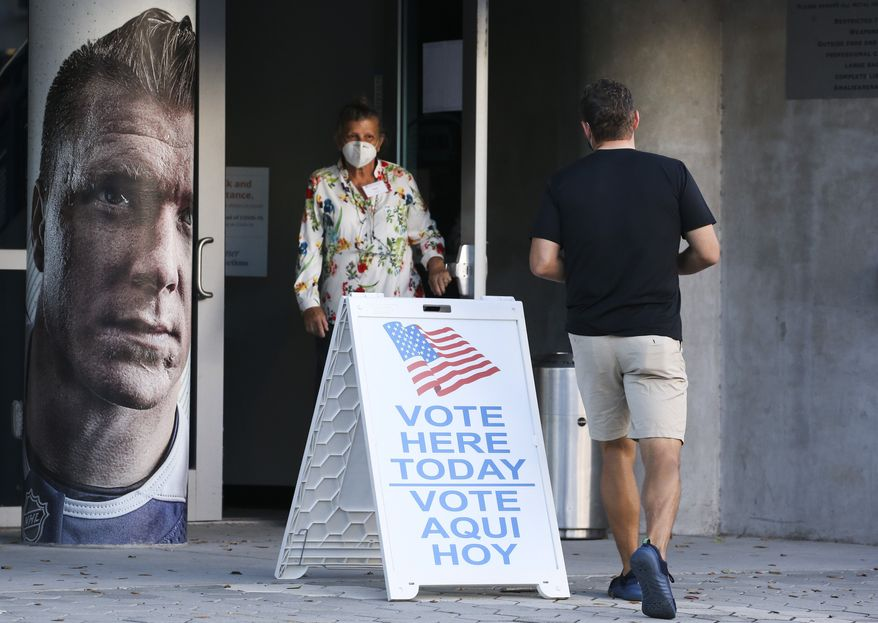 The scene with no lines and no waiting about two hours after the polls opened for early voting at Amalie Arena, Monday, Oct. 19, 2020 in Tampa. (Dirk Shadd/Tampa Bay Times via AP)