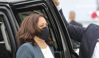 Democratic vice presidential nominee Sen. Kamala Harris, D-Calif., leaves the motorcade to walk to her plane for departure at Orlando International Airport, Monday, Oct. 19, 2020, in Orlando, Fla., after delivering remarks at an early-voting event at the Central Florida Fairgrounds. (Joe Burbank/Orlando Sentinel via AP)