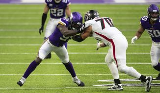 Minnesota Vikings defensive end Yannick Ngakoue (91) in action against Atlanta Falcons offensive tackle Jake Matthews (70) in the first quarter during an NFL football game, Sunday, Oct. 18, 2020, in Minneapolis. The Falcons defeated the Vikings 40-23. (AP Photo/David Berding)
