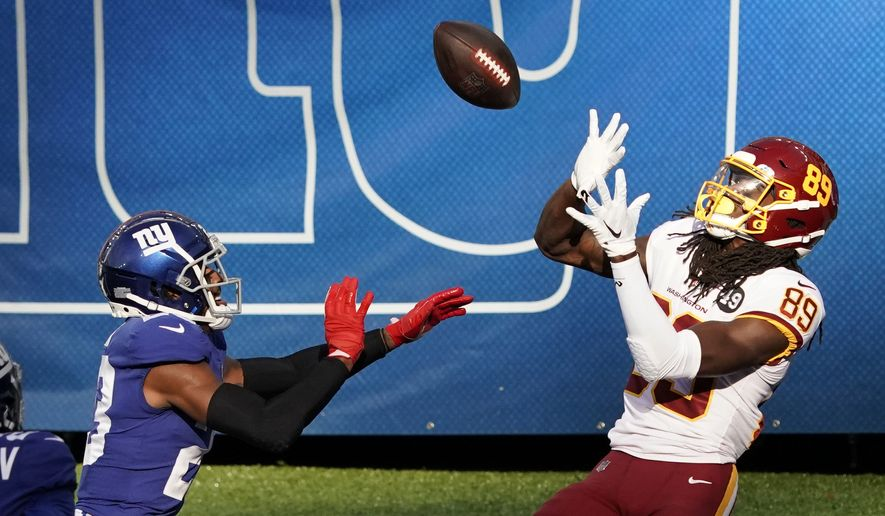Washington Football Team wide receiver Cam Sims (89) catches a pass for a touchdown in front of New York Giants' Logan Ryan (23) during the second half of an NFL football game Sunday, Oct. 18, 2020, in East Rutherford, N.J. The Giants won 20-19. (AP Photo/Bill Kostroun)  **FILE**