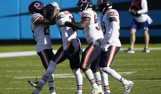 Teammates congratulate Chicago Bears defensive back DeAndre Houston-Carson (36), second from left, following Carson's interception against the Carolina Panthers during the second half of an NFL football game in Charlotte, N.C., Sunday, Oct. 18, 2020. (AP Photo/Brian Blanco)