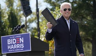 Democratic presidential candidate former Vice President Joe Biden turns from the podium after speaking during a campaign event at Riverside High School in Durham, N.C., Sunday, Oct. 18, 2020. (AP Photo/Carolyn Kaster)