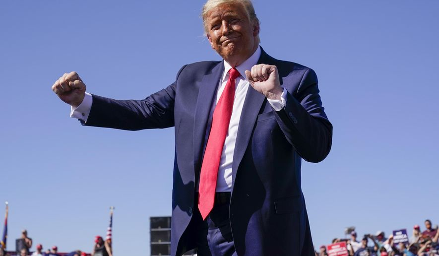 President Donald Trump dances after speaking at a campaign rally at Prescott Regional Airport, Monday, Oct. 19, 2020, in Prescott, Ariz. (AP Photo/Alex Brandon)