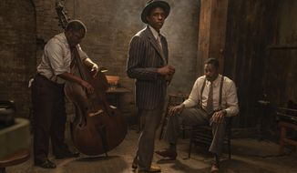 """This image released by Netflix shows Michael Potts, from left, Chadwick Boseman and Colman Domingo in """"Ma Rainey's Black Bottom."""" Netflix on Monday previewed George C. Wolfe's August Wilson adaptation """"Ma Rainey's Black Bottom,"""" showcasing Chadwick Boseman's final performance opposite Viola Davis' powerhouse blues singer. (David Lee/Netflix via AP)"""