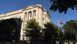 The American flag flies outside of the Justice Department building, Thursday, Oct. 8, 2020, in Washington. (AP Photo/Jacquelyn Martin)  **FILE**