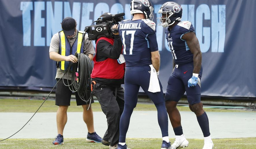 Tennessee Titans wide receiver A.J. Brown (11) celebrates with quarterback Ryan Tannehill (17) after Brown caught a touchdown pass against the Houston Texans in the second half of an NFL football game Sunday, Oct. 18, 2020, in Nashville, Tenn. (AP Photo/Wade Payne)