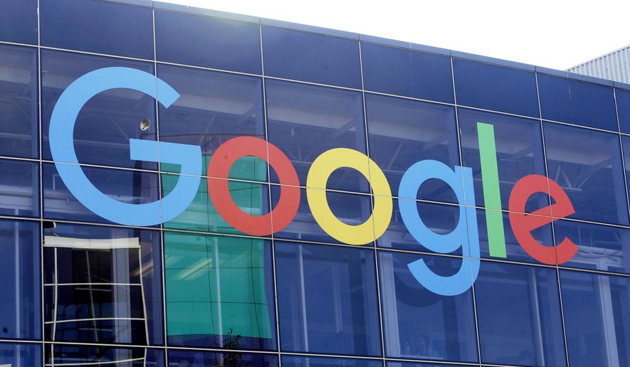In this Sept. 24, 2019, file photo, a sign is shown on a Google building at their campus in Mountain View, Calif. (AP Photo/Jeff Chiu, File)