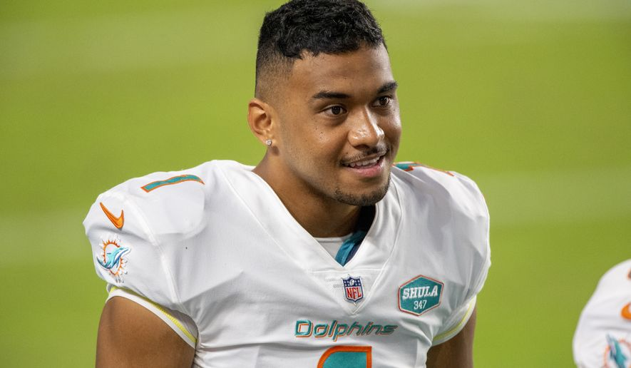 Miami Dolphins quarterback Tua Tagovailoa (1) smiles on the sidelines before playing for the first time against the New York Jets during an NFL football game, Sunday, Oct. 18, 2020, in Miami Gardens, Fla. (AP Photo/Doug Murray)
