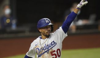 Los Angeles Dodgers' Mookie Betts celebrates a home run against the Tampa Bay Rays during the sixth inning in Game 1 of the baseball World Series Tuesday, Oct. 20, 2020, in Arlington, Texas. (AP Photo/Eric Gay)