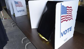 Voting machines are set up and ready for use at the Louisiana Voting Machine Warehouse at 8870 Chef Menteur Hwy. which will be an early voting location in New Orleans, La. Thursday, Oct. 15, 2020. Early voting will run from Oct. 16 to Oct. 27 - except on Sundays - from 8 a.m. to 7 p.m. (Max Becherer/The Times-Picayune/The New Orleans Advocate via AP)