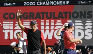 FILE  - In this Oct. 28, 2019, file photo, Tiger Woods celebrates after winning the Zozo Championship golf tournament at the Accordia Golf Narashino country club in Inzai, east of Tokyo, Japan. Woods is the defending champion at a course where he has won five times. The Zozo Championship is the second Asia-based event to move to the United States this year because of the COVID-19 pandemic. (AP Photo/Lee Jin-man, File)