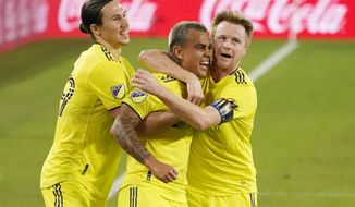 Nashville SC forward Randall Leal, center, celebrates with Alex Muyl, left, and Dax McCarty, right, after Leal scored a goal against FC Dallas during the first half of an MLS soccer match Tuesday, Oct. 20, 2020, in Nashville, Tenn. (AP Photo/Mark Humphrey)
