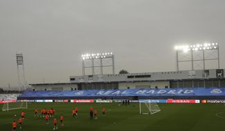 Shakhtar's players exercise during a training session at Alfredo di Stefano stadium in Madrid, Spain, Tuesday, Oct. 20, 2020. Real Madrid will play against FC Shakhtar Donetsk in a Champions League soccer match on Wednesday. (AP Photo/Manu Fernandez)